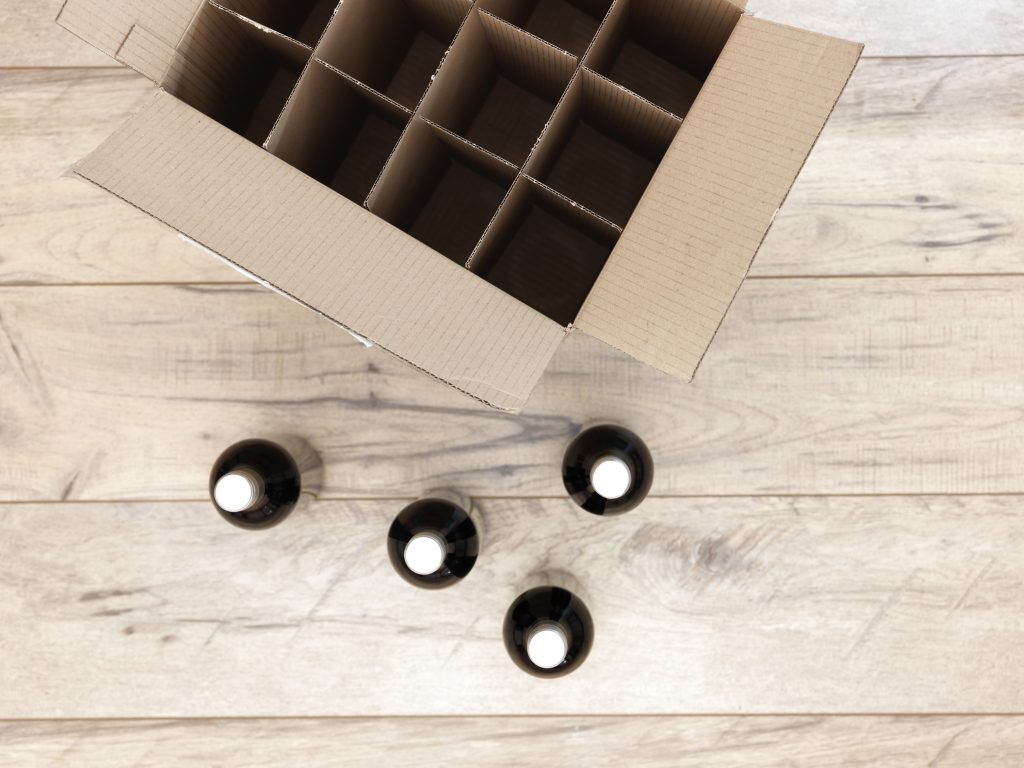 Overview of wine bottles and cardboard shipping box for wine.